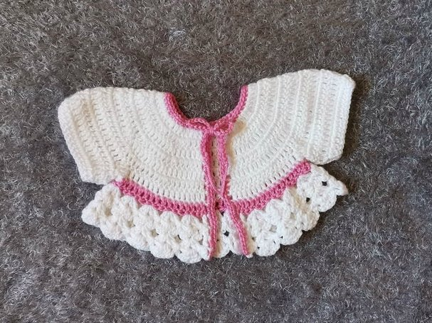 white crochet baby jacket